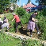 Workcamp of volunteers preparing terain for vineyard